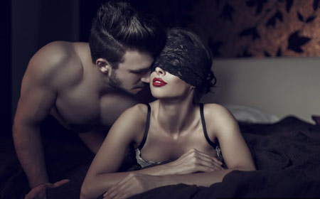 A man arousing a woman
