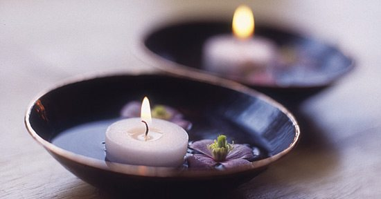 Relaxing candles help set the mood for erotic massage