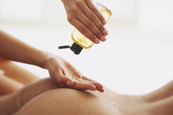 Applying massage oil